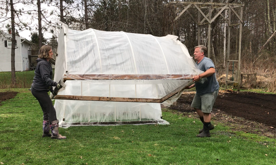 John and Kerry Young of Jericho hoist a hoop house into position in preparation for growing a giant pumpkin on May 1, 2018. Behind them, on the right, is a trellis on which the couple grew an 11-foot long gourd.