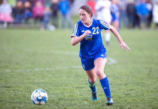 Colchester's Summer Hathaway chases a loose ball during Thursday's high school girls soccer game in Colchester on Oct. 18, 2018.