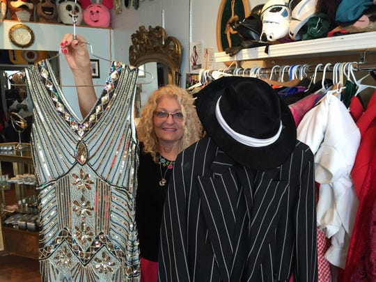 Flapper and gangster costumes are popular at the Triple Loop Costume Shop in Essex Junction, according to owner Laurie Browne.