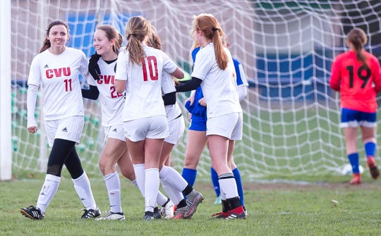 Champlain Valley players react after scoring a goal in the second half against Colchester during Thursday's high school girls soccer game in Colchester on Oct. 18, 2018.