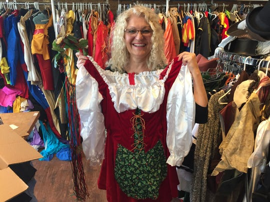 Laurie Browne, owner of the Triple Loop Costume Shop in Essex Junction, models a Mrs. Claus outfit.