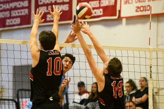 CVU's Noah Allen (10) and Cooper Snipes (18) tries to block a shot from South Burlington during the boys volley ball game between the South Burlington Wolves and the Champlain Valley Union Redhawks at CVU High School on Thursday afternoon October 18, 2018 in Hinesburg.