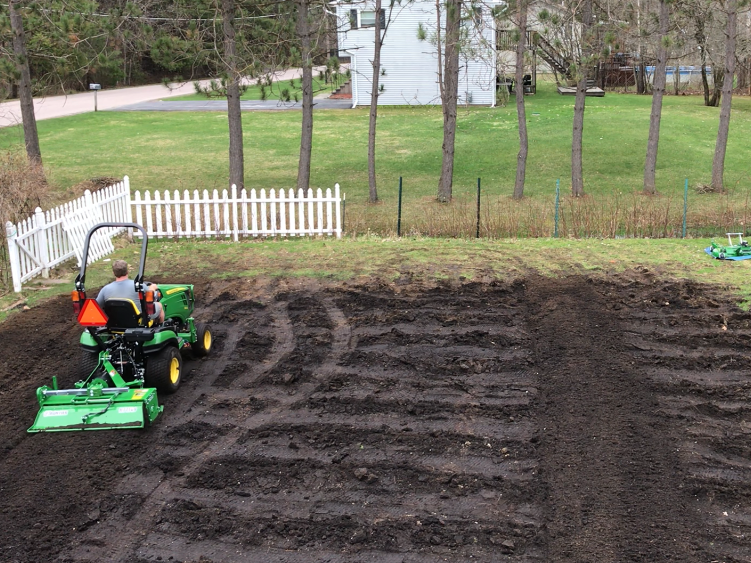 John Young of Jericho tills 12 cubic yards of compost into his pumpkin patch on May 1, 2018.