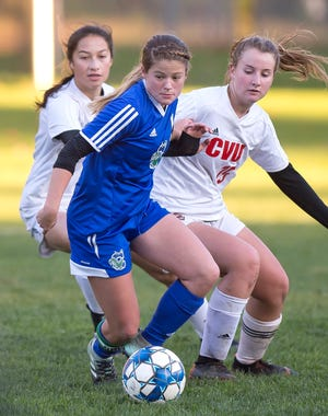 Colchester's Madison Finelli fends off pressure by Champlain Valley during Thursday's high school girls soccer game in Colchester on Oct. 18, 2018.