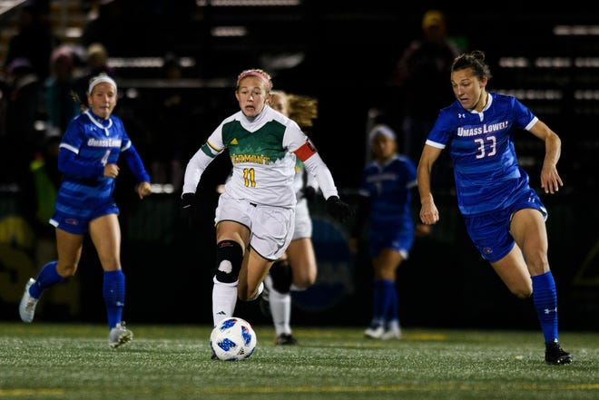 Vermont's Brooke Jenkins (11) and UMass' Kristina Bartsch (33) chase down the ball during the women's soccer game between the UMass Lowell Riverhawks and the Vermont Catamounts at Virtue Field on Thursday night October 18, 2018 in Burlington.
