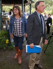 Vermont Republican incumbent Gov. Phil Scott, right, and Democratic challenger Christine Hallquist, center, walk from a gazebo following a debate at the Tunbridge World's Fair in Tunbridge, Vt.