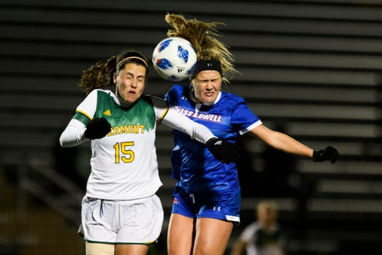 Vermont's Anna Keimel (15) and UMass' Veronica Morrier (9) battle to head the ball during the women's soccer game between the UMass Lowell Riverhawks and the Vermont Catamounts at Virtue Field on Thursday night October 18, 2018 in Burlington.