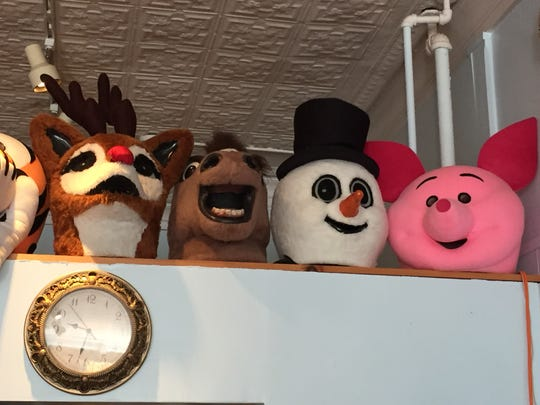 Mascot heads greet visitors to the Triple Loop Costume Shop in Essex Junction.