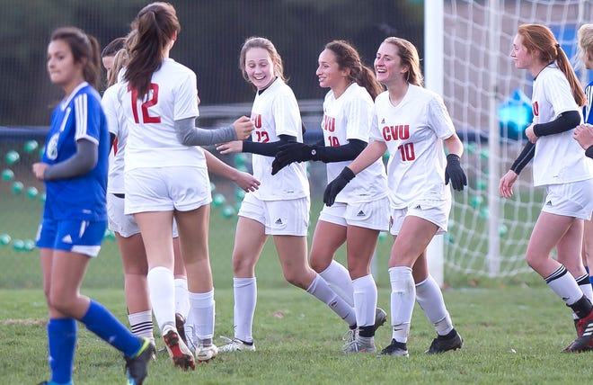 Champlain Valley players celebrate a second-half goal against Colchester during Thursday's high school girls soccer game in Colchester on Oct. 18, 2018.