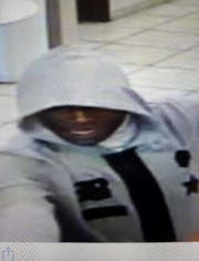 A surveillance photo of the man who robbed a Value Bank.