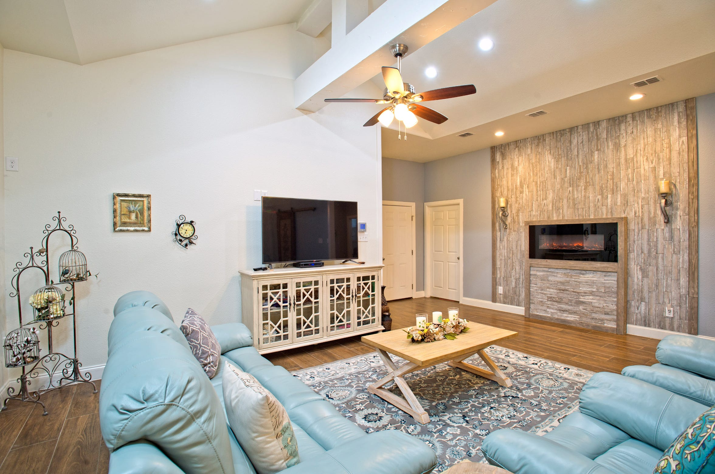 The spacious living area is highlighted by a cool fireplace wall which highlights the electric fireplace beautifully and a unique cathedral ceiling.