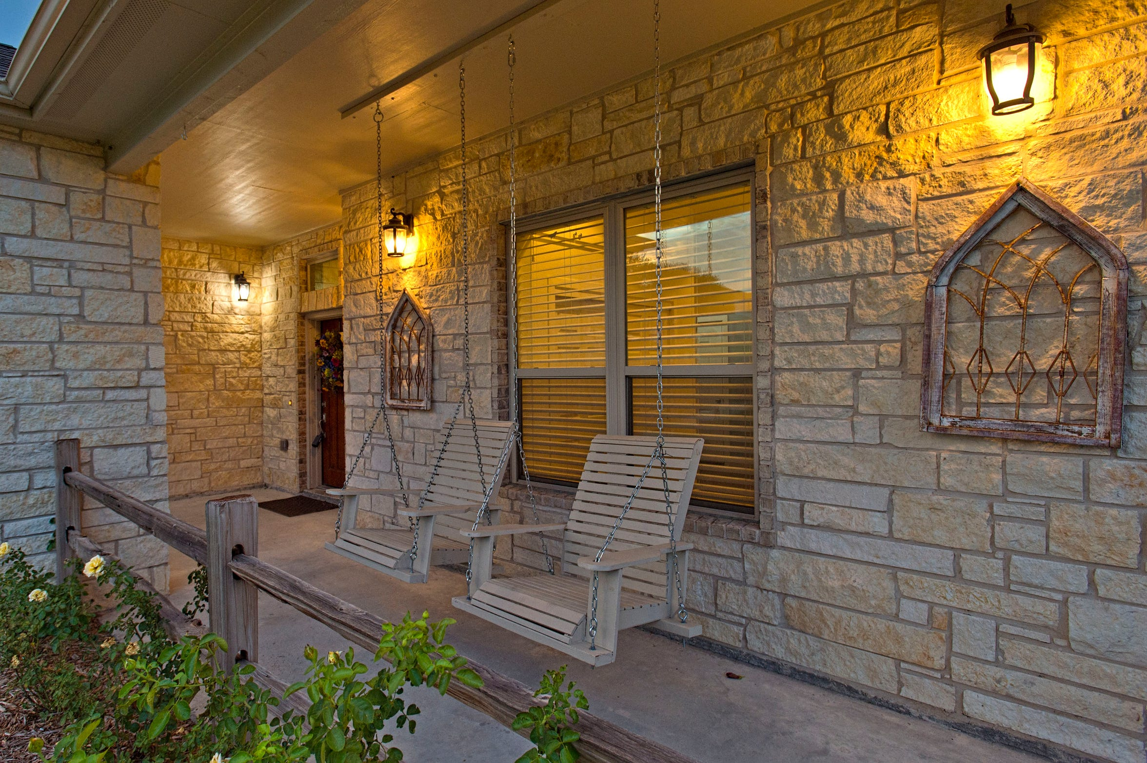 Hang out on a porch swing and enjoy the serenity of Wood Estates