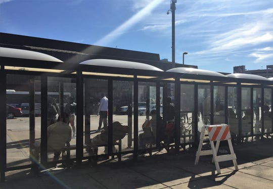 People fill bus shelters at the Rand Transportation Center in Camden on Friday morning.