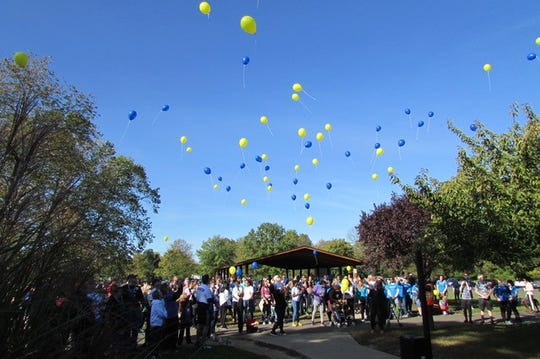 Participants gather at Laurel Acres Park in Mount Laurel at a previous Burlington County Out of the Darkness walk. While it's a national event, the Burlington County edition was started by Kyra Berry, who was a junior at Lenape High at the time. The event is held to raise funds and awareness about suicide prevention.