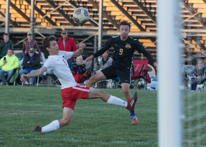 Unioto's Ethan Kerns attempts a goal kick to score for Unioto during the last ten minutes of the game Thursday night at Unioto High School. Alexander defeated Unioto 1-0.