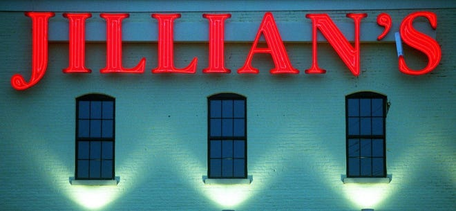 The sign for Jillian's blares from the side of the former BrewWorks in Covington. photo by Aimee Obidzinski for The Enquirer