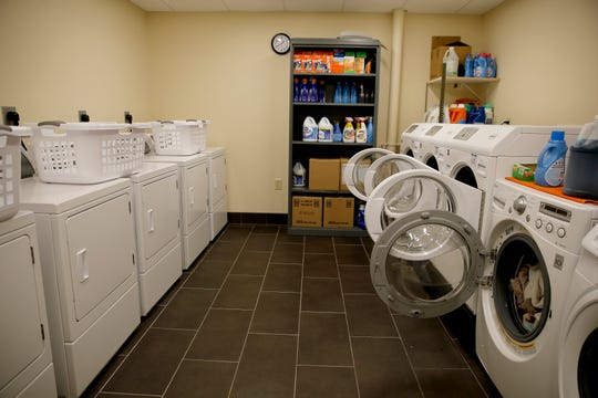 Staff and volunteers average 60-85 loads of laundry a day at Mary Magdalen House in Over-the-Rhine.