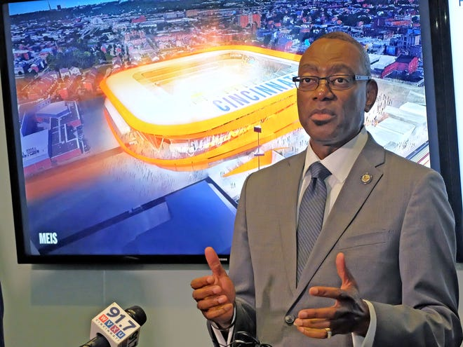 Former Mayor Mark Mallory speaks to the press Friday about the construction plans for the FC Cincinnati stadium in West End.