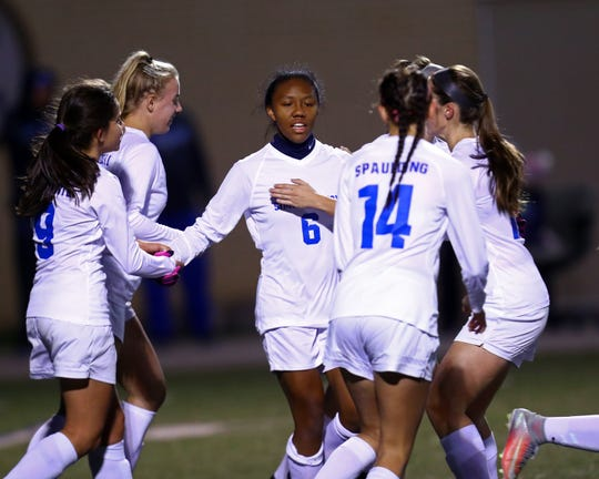 Simon Kenton midfielder Cayla Coleman is congratulated by her teammates for her goal in the first half in the Eighth Region final girls soccer match between South Oldham and Simon Kenton High School at Simon Kenton.