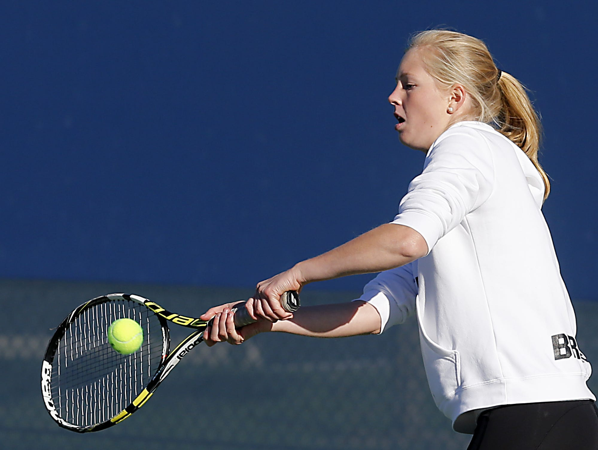 Indian Hill's Nina Price returns a volley during the Division II doubles bracket at the Lindner Family Tennis Center in Mason Friday, Oct. 19, 2018.