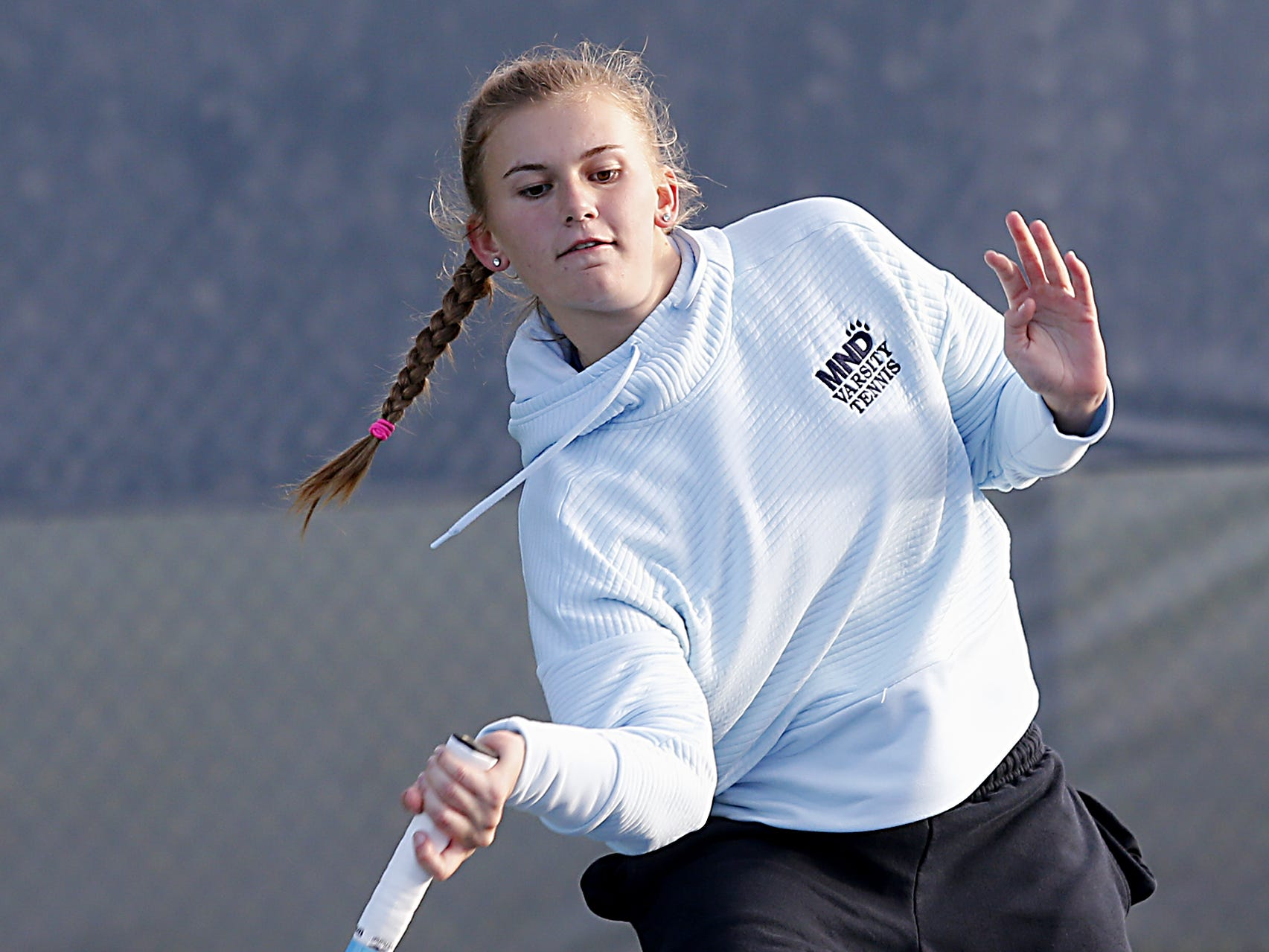 Kelli Niehaus, of Mount Notre Dame, returns a volley during her Division I singles bracket at the Lindner Family Tennis Center in Mason Friday, Oct. 19, 2018.