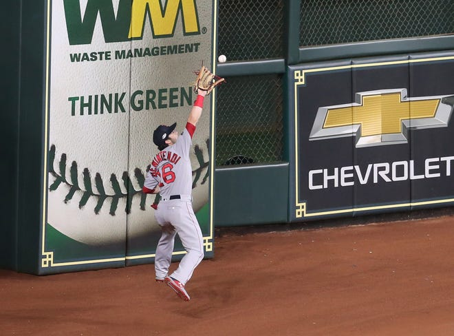 Boston Red Sox outfielder Andrew Benintendi (16) catches a fly ball in the ninth inning against the Houston Astros in game five of the 2018 ALCS playoff baseball series at Minute Maid Park.