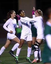 Simon Kenton midfielder Cayla Coleman and teammates Madison Vehige [left] and Tatum Ponzer celebrate Coleman's goal in the Eighth Regional Final Girls Soccer match between South Oldham and Simon Kenton High School at Simon Kenton. Simon Kenton defeated South Oldham 1-0 to claim the Eighth Region Championship.