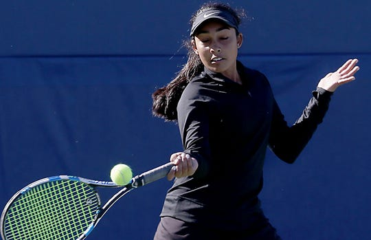 Mason's Raina Chada returns a volley during the Division I doubles bracket at the Lindner Family Tennis Center in Mason Friday, Oct. 19, 2018.