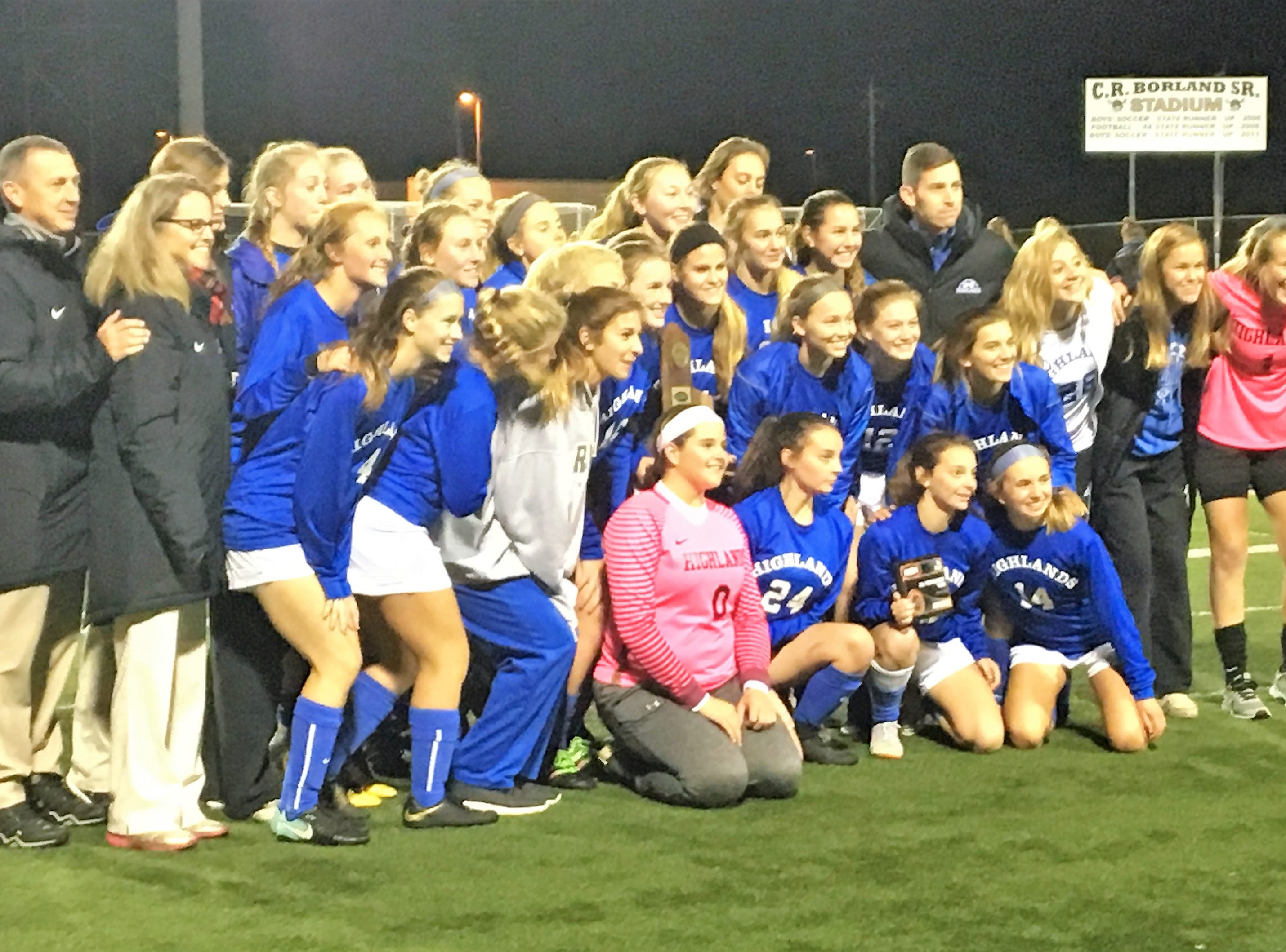 Highlands Bluebirds celebrate with their regional championship trophy during Highlands' 1-0 win over Notre Dame in the 9th Region girls soccer championship game Oct. 18, 2018, at Ryle High School, Union, Ky.