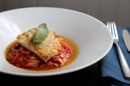 The Atlantic cod, with peperonata, arugula pesto, fresh pressed extra virgin olive oil, pictured, Friday, Oct. 19, 2018, at Forno restaurant in Montgomery, Ohio.