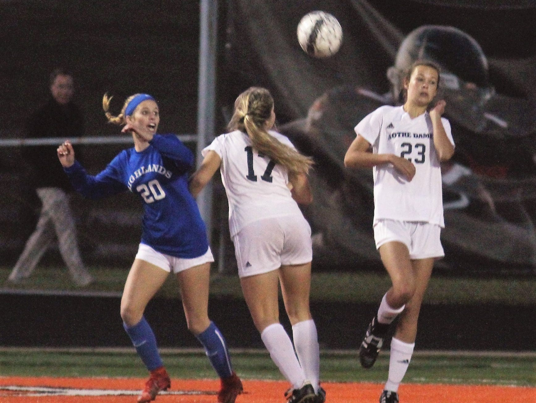 Highlands junior Maria Wiefering, 20,  battles for the ball with Notre Dame junior Ellie Hellmann, 17, and freshman Natalie Bain, 23, during Highlands' 1-0 win over Notre Dame in the 9th Region girls soccer championship game Oct. 18, 2018 at Ryle High School, Union, Ky.