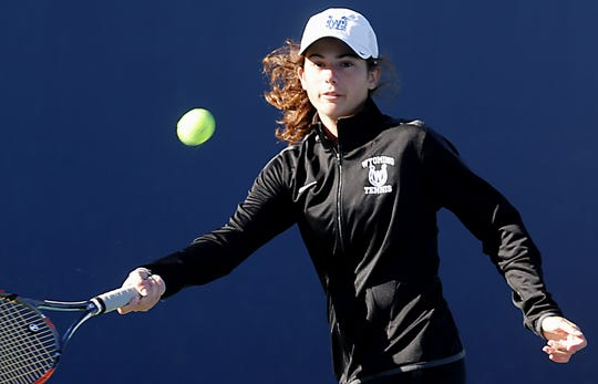Wyoming's Peyton Osha returns a volley during the Division II doubles bracket at the Lindner Family Tennis Center in Mason Friday, Oct. 19, 2018.