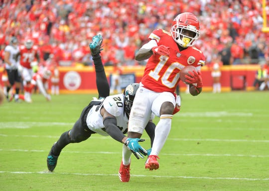 Kansas City Chiefs wide receiver Tyreek Hill (10) runs the ball against Jacksonville Jaguars cornerback Jalen Ramsey (20) during the second half at Arrowhead Stadium.