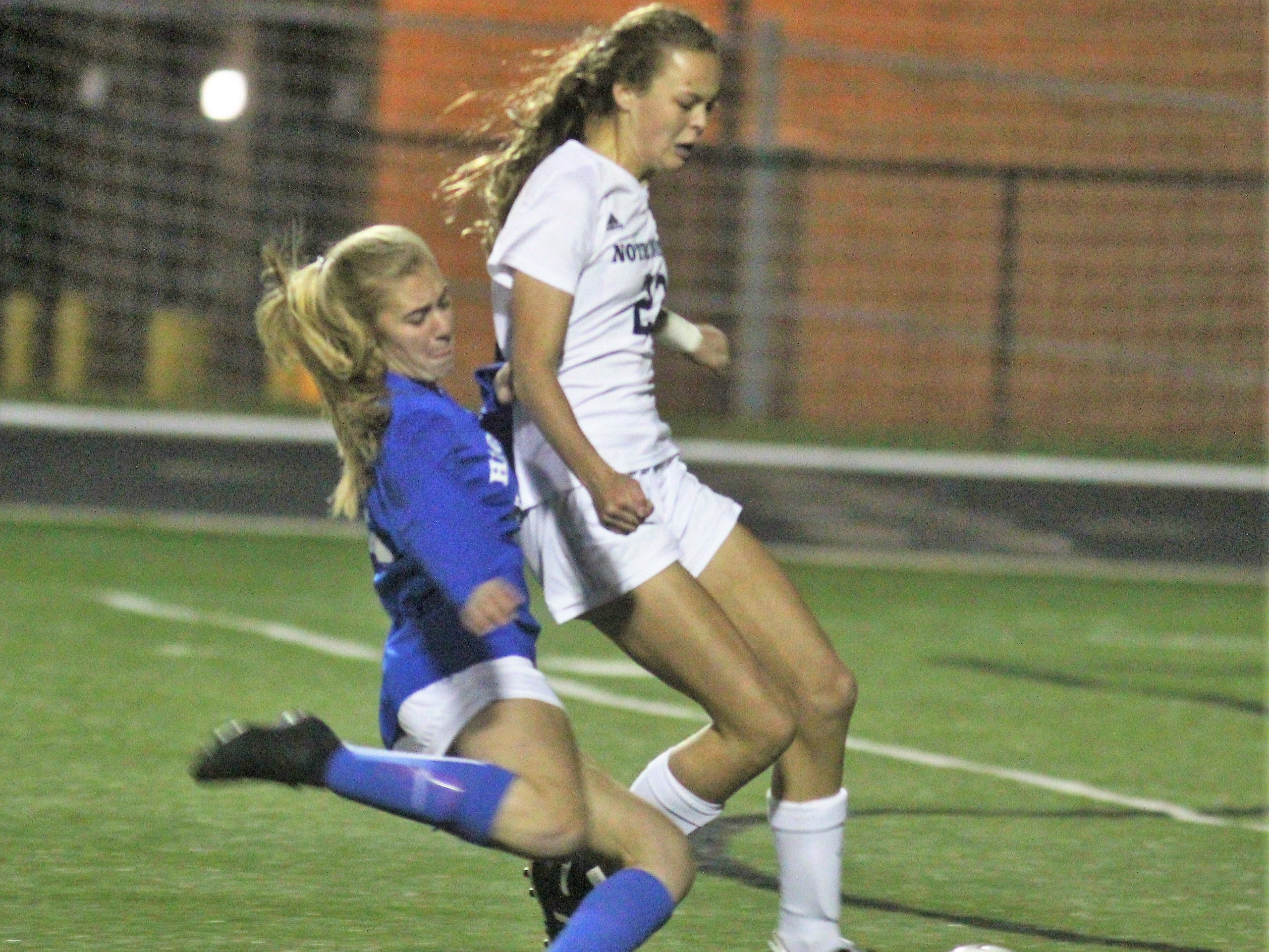 Highlands freshman Chloe Bramble, blue, gets the shot off under heavy pressure from Notre Dame freshman Natalie Bain and scores the only goal of the game from 20 yards out during Highlands' 1-0 win over Notre Dame in the 9th Region girls soccer championship game Oct. 18, 2018 at Ryle High School, Union, Ky.