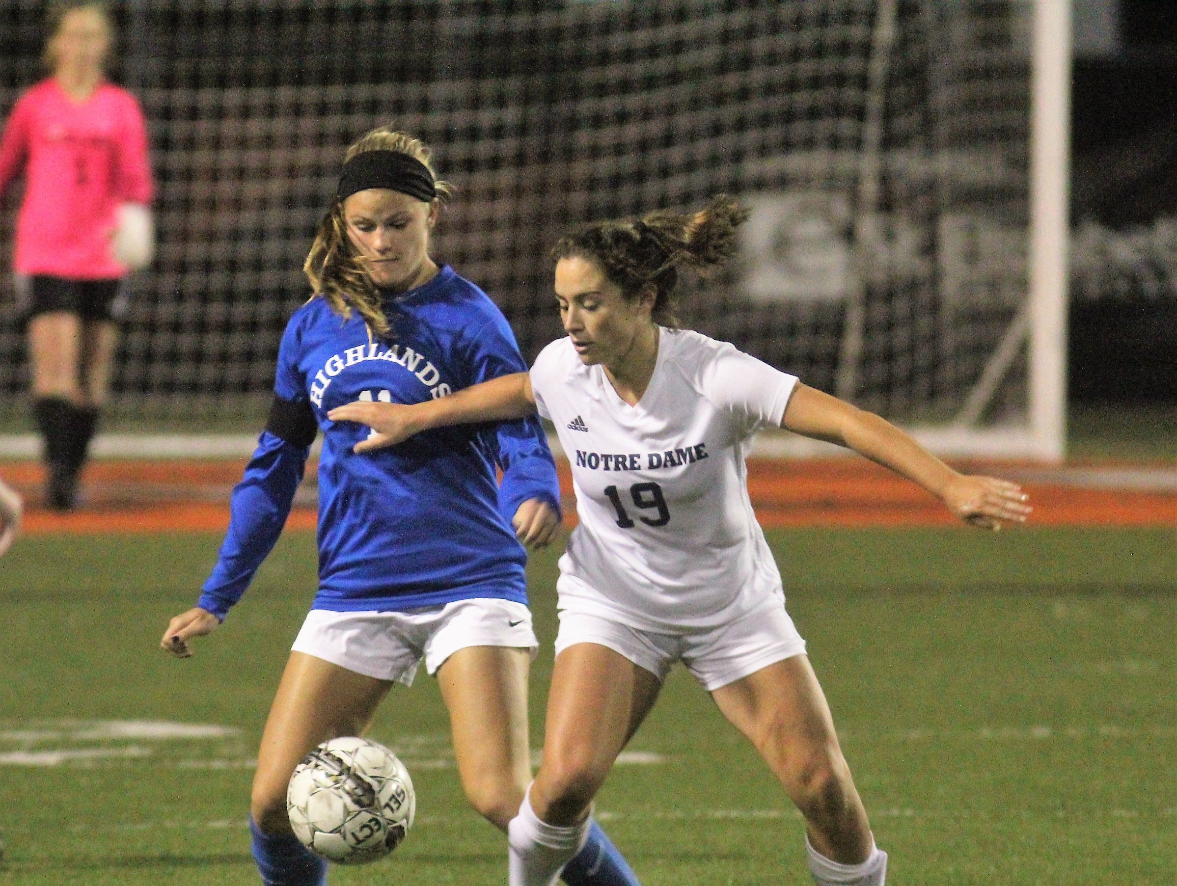 Highlands senior Hannah Hartman, left, and Notre Dame senior Lily Dorning battle for the ball during Highlands' 1-0 win over Notre Dame in the 9th Region girls soccer championship game Oct. 18, 2018 at Ryle High School, Union, Ky.