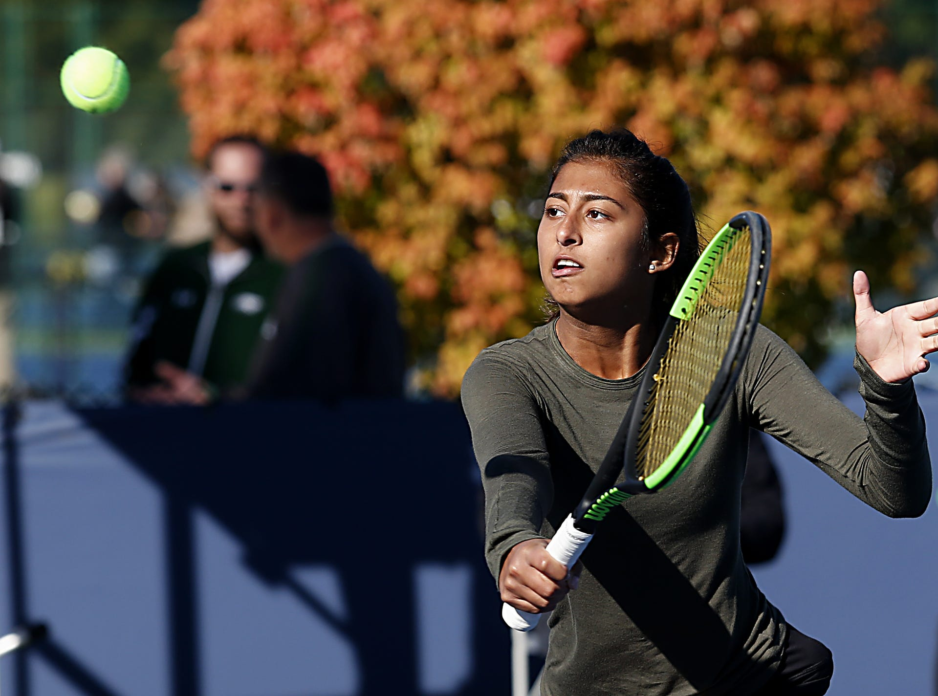 Ursuline's Nina Dhaliwal returns a volley during the Division I doubles bracket at the Lindner Family Tennis Center in Mason Friday, Oct. 19, 2018.