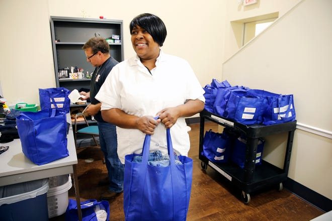 """I can make sure they smell good. They don't have to look like they are homeless"" Alysia Barker, an employee of the Mary Magdalen House, said about washing and folding guests' clothes."