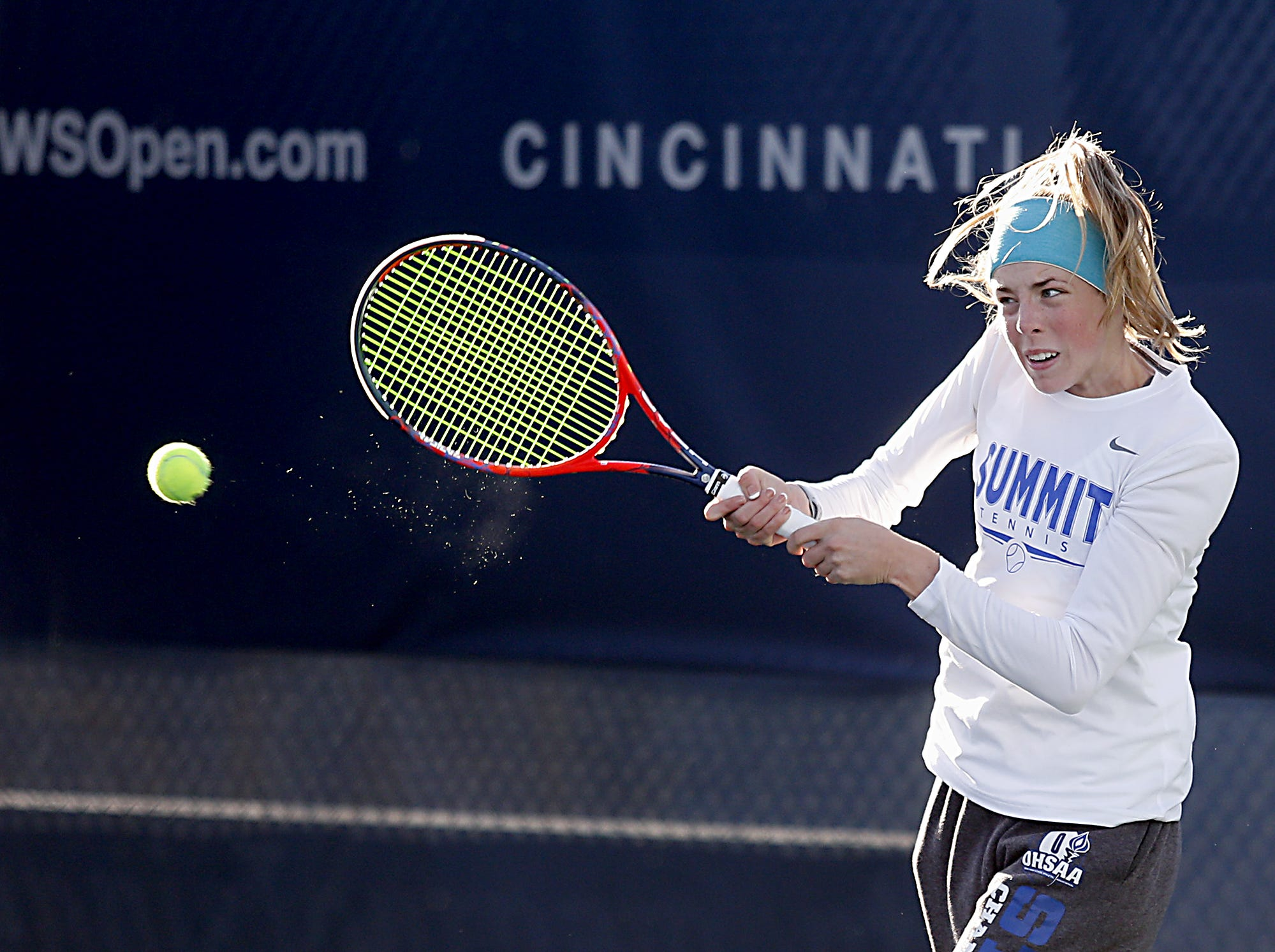 Elizabeth Fahrmeier, of Summit Country Day, returns a volley during her Division II singles bracket at the Lindner Family Tennis Center in Mason Friday, Oct. 19, 2018.