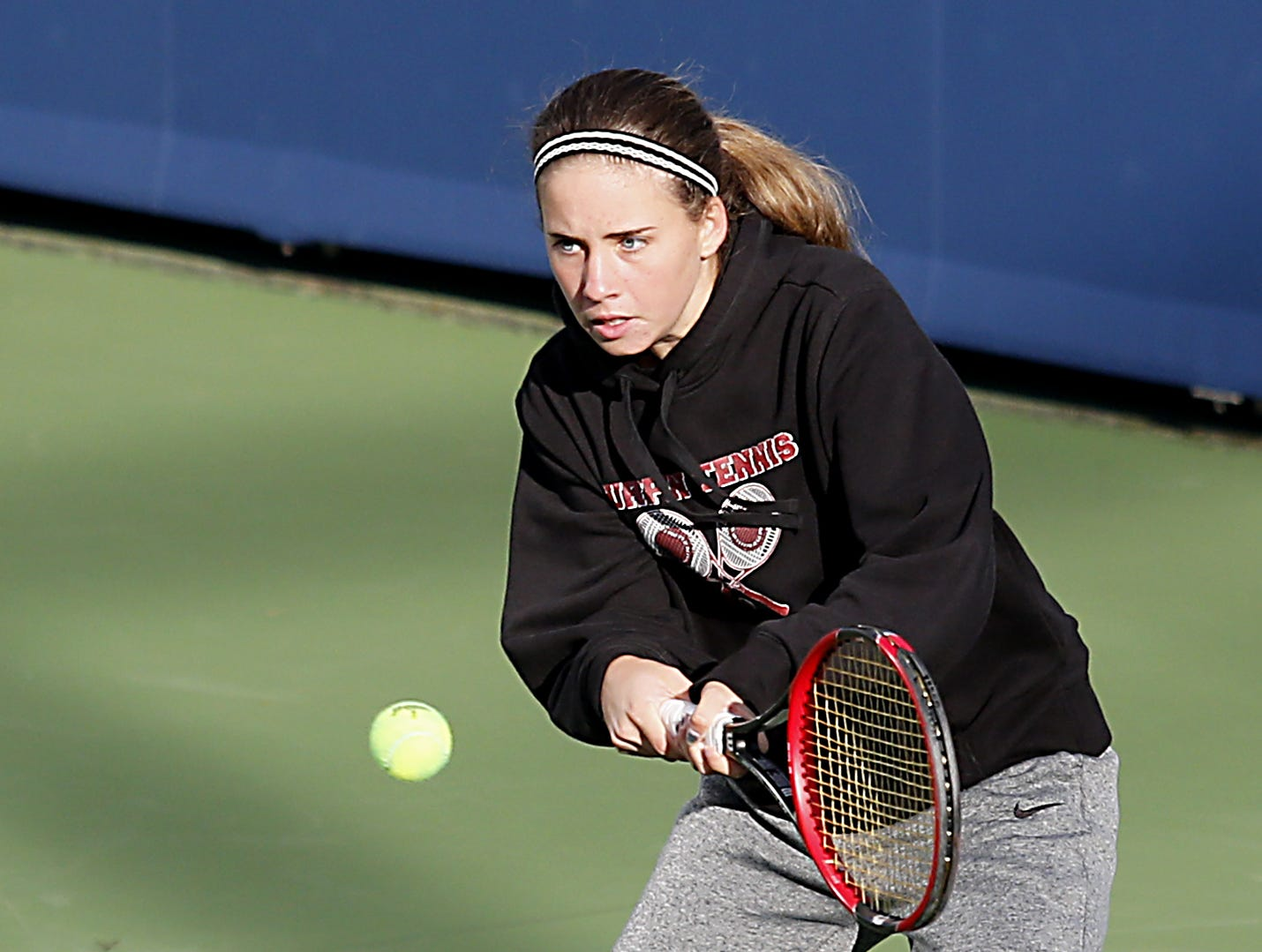Turpin's Caitlin Fisher returns a volley during her Division I singles bracket at the Lindner Family Tennis Center in Mason Friday, Oct. 19, 2018.