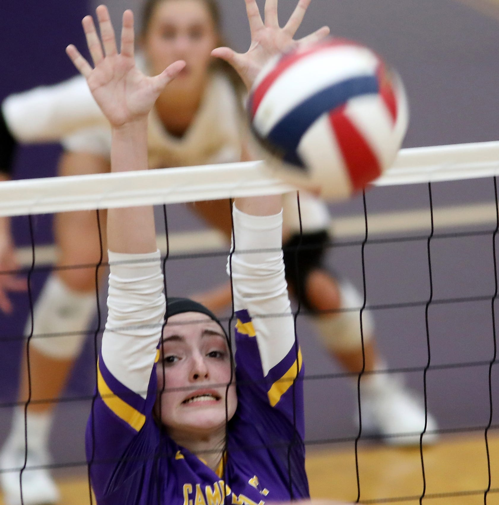 Campbell County player Lauren Vineyard tries to block a kill attempt during their 10th region tournament match against Harrison County, Thursday, Oct.18, 2018.