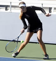 Mason's Annie Kruse returns a volley during the Division I doubles bracket at the Lindner Family Tennis Center in Mason Friday, Oct. 19, 2018.