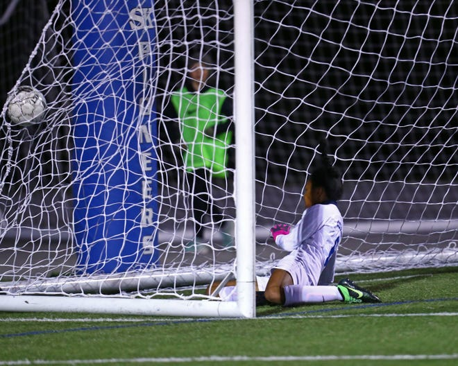 Simon Kenton midfielder Cayla Coleman heads the ball in for a goal in the first half in the Eighth Region final girls soccer match between South Oldham and Simon Kenton High School at Simon Kenton.