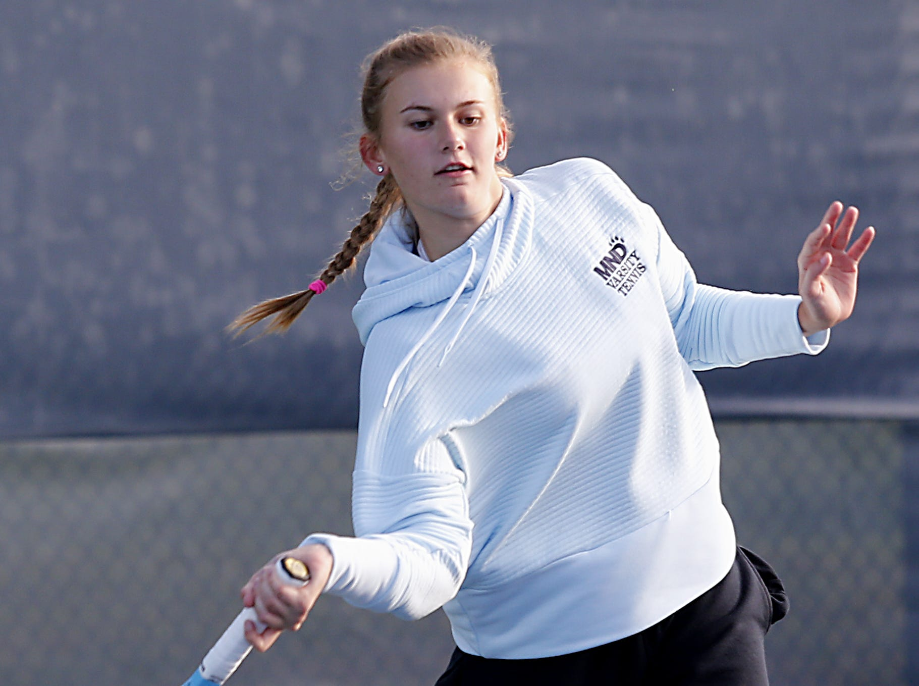 Kelli Niehaus of Mount Notre Dame returns a volley during her Division I singles bracket at the Lindner Family Tennis Center in Mason Friday, Oct. 19, 2018.