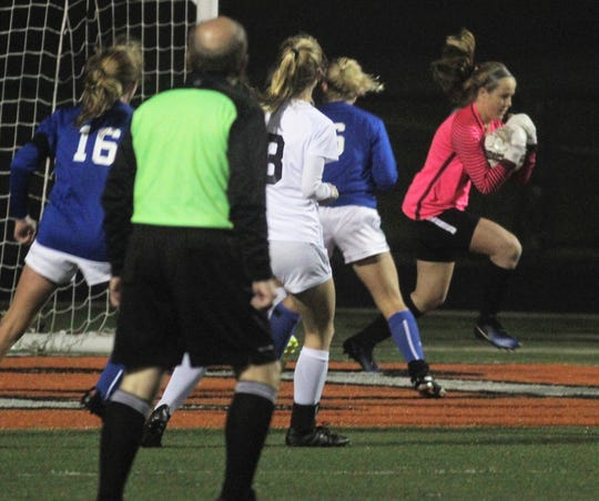 Highlands keeper Maggie Hinegardner grabs a pass into the goal box during Highlands' 1-0 win over Notre Dame in the 9th Region girls soccer championship game Oct. 18, 2018 at Ryle High School, Union, Ky.