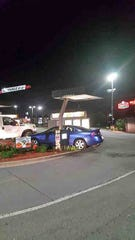 A man crashed this stolen Mercury into the Wendy's on Wilma Rudolph Boulevard Thursday night.