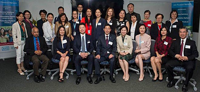 Members of the AIG Financial Network team celebrate the one-year anniversary of the opening of the group's Edisonoffice. The financial professionals and support staff, all of whom are fluent in English and one or more Asian languages, help educate the community on life insurance and retirement planning.