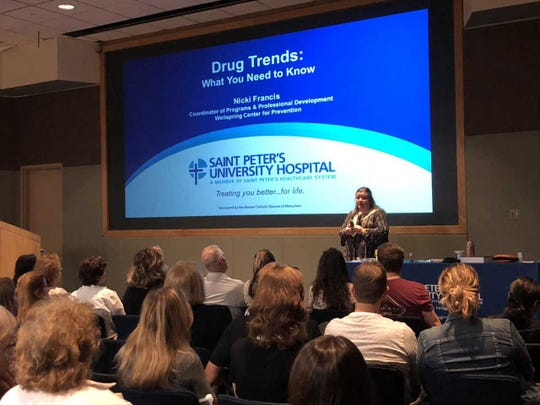 "Nicki Francis, preventionist from the Wellspring Center for Prevention addresses concerned citizens at the recent Opioid Task Force Community Education event held at Saint Peter's University Hospital. The event covered drug trends, red flags and warning signs. Part II of the community education program takes place on Wednesday, Nov. 7. ""The Opioid Crisis: Getting on the Road to Recovery,"" will inform the public about inpatient and outpatient treatment options and offer insights from recovery coaches who have been there. The program runs from 6:30 to 8:30 p.m. at Saint Peter's University Hospital, 254 Easton Ave. in New Brunswick. To RSVP, contact Marcia Linico at mlinico@saintpetersuh.com."