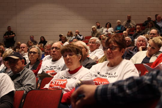 Coshocton residents listen to Ohio EPA officials explain the Class I permits.