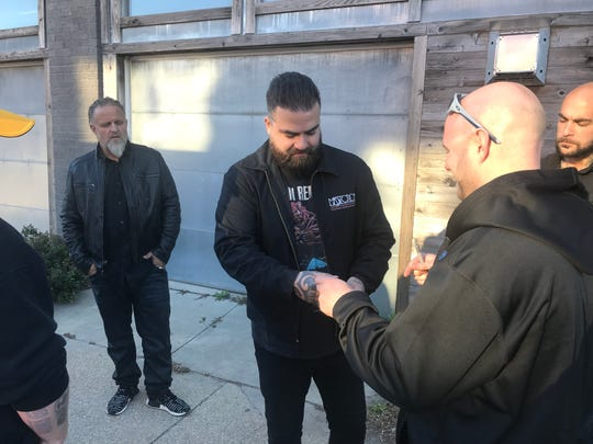 Slipknot bassist Alessandro Venturella signs autographs outside the Black Sheep in Des Moines, Iowa on Oct. 18, 2018.