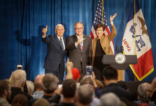United States Vice President Mike Pence, left, stands with Iowa congressman David Young and Iowa Gov. Kim Reynolds during a campaign visit to Des Moines on Friday, Oct. 19, 2018.